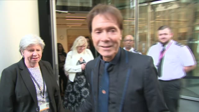 exterior shots of cliff richard arriving and departing from the high court during his trial to sue the bbc over their coverage of a police raid on... - cliff richard stock videos and b-roll footage
