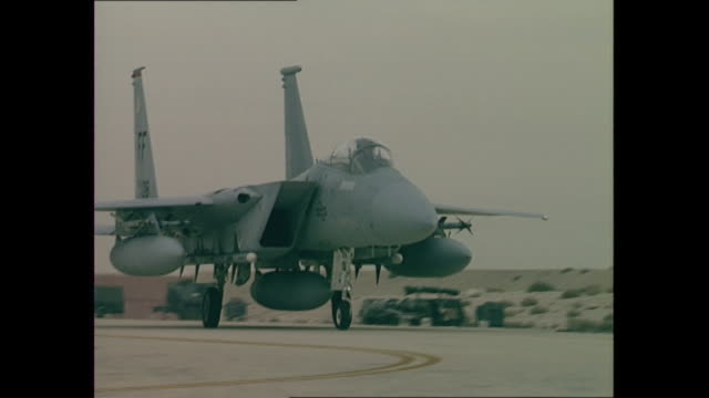 exterior shots of coalition fighter jets at dhahran airbase on the fist day of operation desert storm including a pilot sat in the cockpit of an raf... - operation desert storm bildbanksvideor och videomaterial från bakom kulisserna