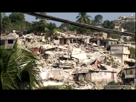 exterior shots of collapsed buildings damaged by earthquake and rubble in streets earthquake destroys buildings in port au prince on january 23 2010... - haiti stock videos & royalty-free footage