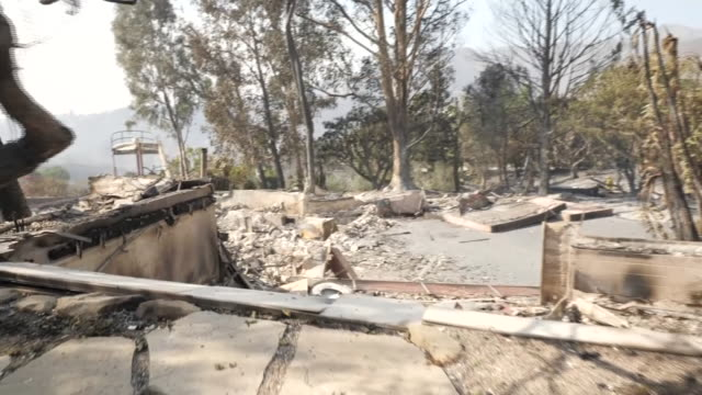 exterior shots of completely burned and damaged house after the wildfire on the 12 of november in malibu california united states - malibu stock-videos und b-roll-filmmaterial