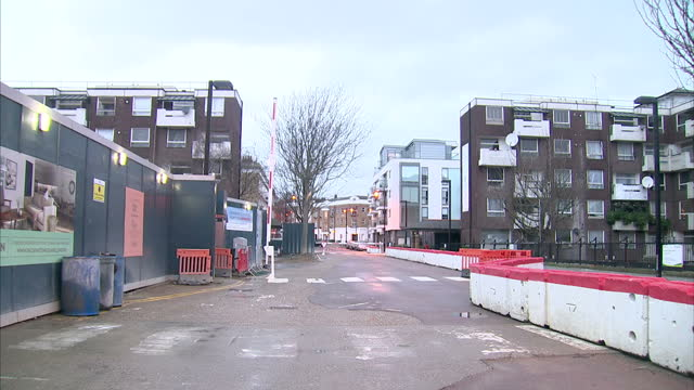 exterior shots of condemned council flats and new council housing under construction on a building site in islington on january 10 2016 in rochdale... - council flat stock videos & royalty-free footage