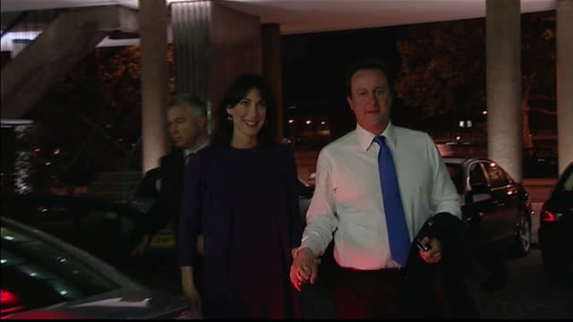 stockvideo's en b-roll-footage met exterior shots of conservative leader david cameron and wife samantha cameron arriving by car at conservative central office and entering the... - directrice