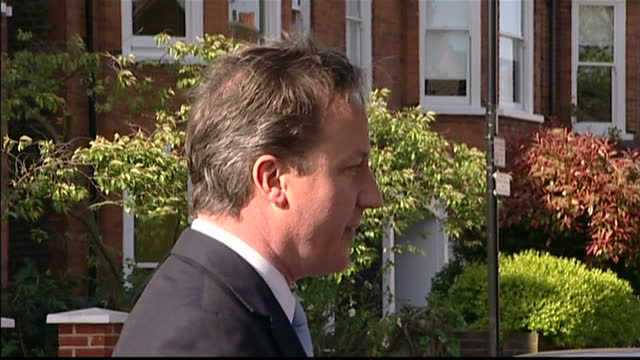 exterior shots of conservative leader david cameron making a statement outside his west london house on the lack of progress in talks between... - british liberal democratic party stock videos & royalty-free footage