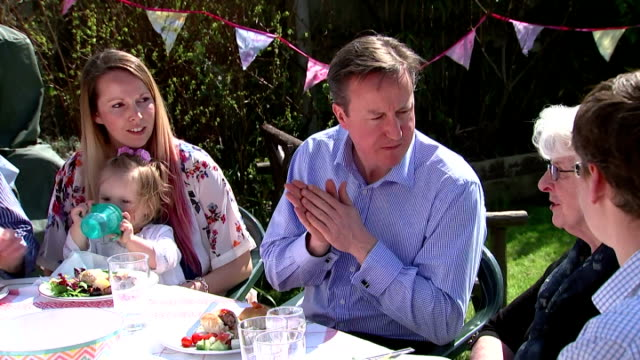 exterior shots of conservative party leader david cameron attending a family bbq eating and chatting to locals on april 06 2015 in poole england - british liberal democratic party stock videos & royalty-free footage