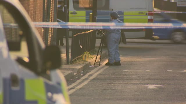 exterior shots of cordoned off road with police and forensics officers at shooting scene on 6 may 2018 at harrow, london, united kingdom - harrow stock videos & royalty-free footage