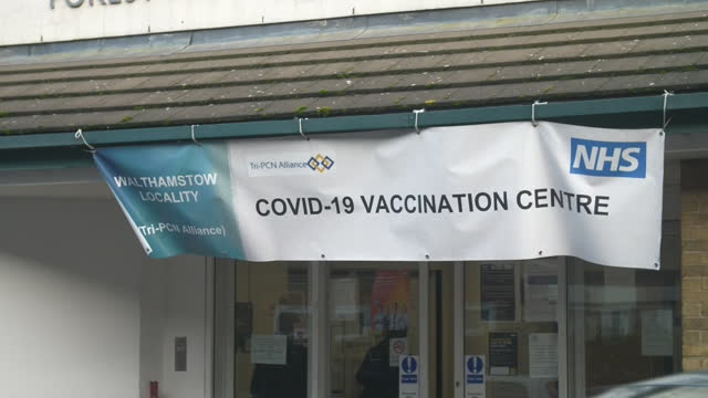 exterior shots of covid-19 coronavirus vaccination centre on 6 january 2021 in walthamstow, united kingdom. - sign stock videos & royalty-free footage