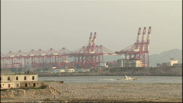 exterior shots of cranes and ships in a deep water container port in shanghai on october 21, 2008 in shanghai, china. - film container stock videos & royalty-free footage
