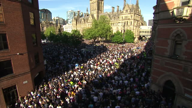 Exterior shots of crowd of well wishers gathered in square for vigil to pay respects to the victims of the Manchester terror attack on 23rd May 2017...