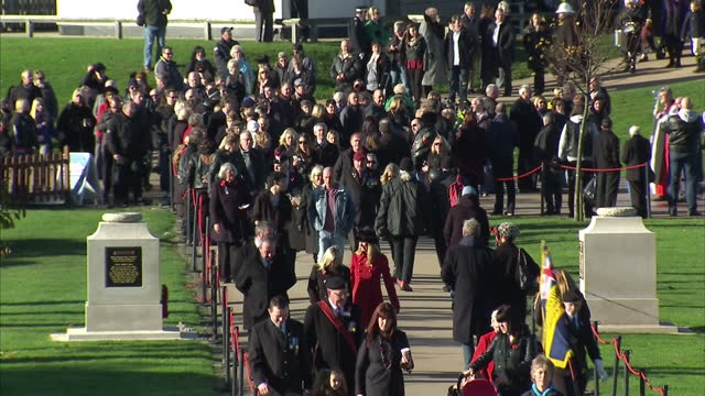 exterior shots of crowds arriving at national arboretum for poppy wreath laying ceremony on remembrance sunday crowds arriving for remembrance sunday... - lichfield stock videos & royalty-free footage