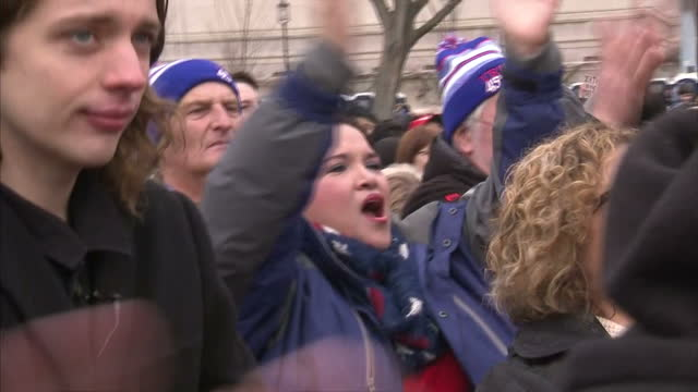 Exterior shots of crowds cheering and chanting 'USA USA' during the inauguration of Donald Trump on the National Mall on January 20 2017 in...