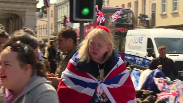 exterior shots of crowds fans and supporters gathered in the streets of windsor wearing union jack flags including shots of canadian visitors camping... - souvenir stock videos and b-roll footage