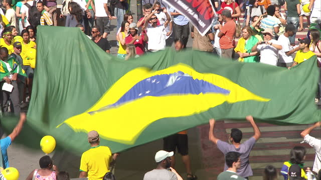 vídeos de stock, filmes e b-roll de exterior shots of crowds gathers to march in union led strikes. security police patrol streets of rio de janeiro during protests. on june 22, 2013 in... - política