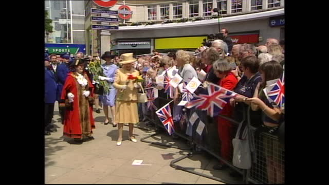exterior shots of crowds lining the street behind barriers as queen elizabeth ii and prince philip duke of edinburgh greet officials and well-wishers... - belly stock videos & royalty-free footage
