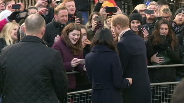 Exterior shots of crowds lining the streets of Nottingham cheering as Meghan Markle and Prince Harry can be seen greeting members of the public on...