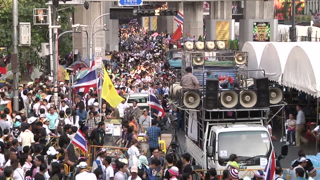 exterior shots of crowds of antigovernment protesters filling roads and overpasses in bangkok with makeshift protest camps antigovernment protesters... - resourceful stock videos & royalty-free footage