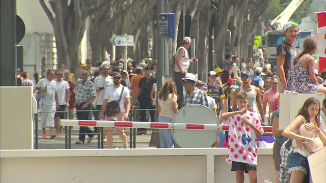 exterior shots of crowds of cycling fans and a few armed police gathered to welcome the tour de france on 22 july 2017 in marseille, france - toulouse stock videos & royalty-free footage