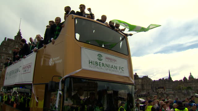 Exterior shots of crowds of football supporters for the Hibs celebrating as the victory bus parade drives past all fans wearing green on May 22 2016...