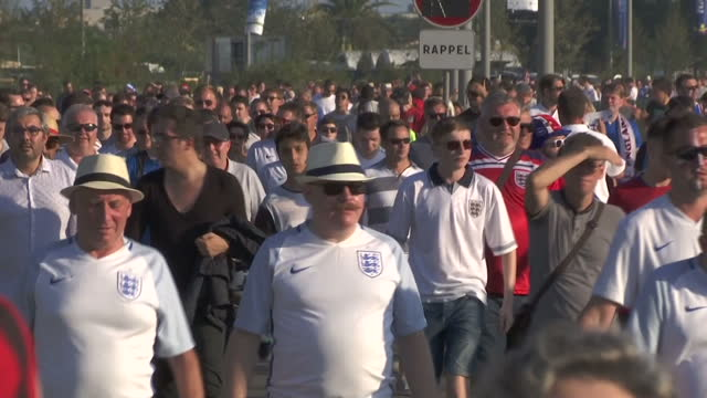 vídeos de stock, filmes e b-roll de exterior shots of crowds of iceland and england football supporters walking towards the allianz riviera stadium ahead of the euro 2016 match >> on... - euro 2016