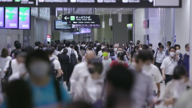 exterior shots of crowds of people walking through kawasaki station wearing face masks on 10 september 2020 in kawasaki, japan. - group of people stock videos & royalty-free footage