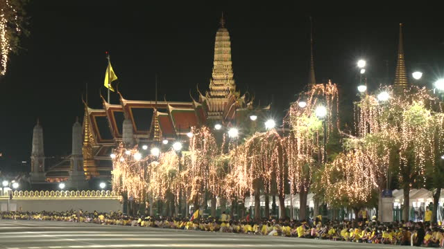 THA: The King of Thailand is taking part in a candle lightening ceremony in memory of his father on the anniversary of his birthday.