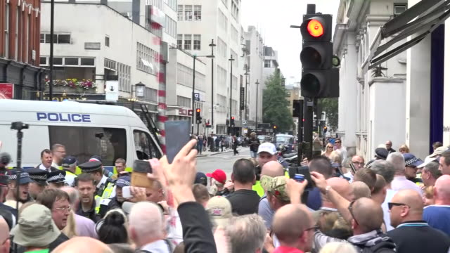 exterior shots of crowds of protesters calling for the release of right-wing activist tommy robinson during a 'free tommy' demonstration, chanting... - releasing stock videos & royalty-free footage