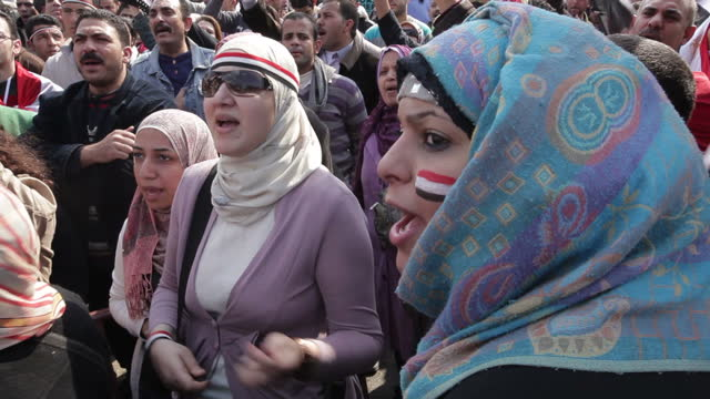 exterior shots of crowds of protesters march with posters flags calling for president mubarak to step down on february 11 2011 in cairo egypt - revolution stock videos & royalty-free footage