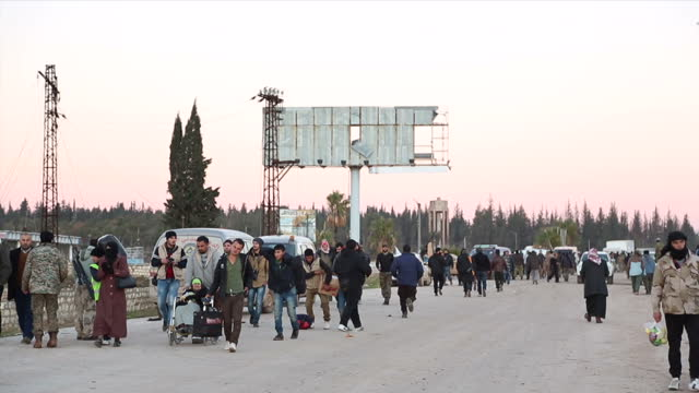 exterior shots of crowds of refugees from eastern aleppo in road on december 16 2016 in aleppo syria - シリア難民問題点の映像素材/bロール