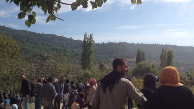 Exterior shots of crowds of refugees on the Syrian side of the Syria Turkish border fence near the Turkish village of Guvecci gathered in a makeshift...