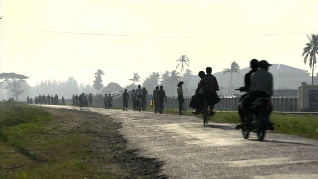 Exterior shots of crowds of Rohingya refugees walking and stood in refugee camp including groups of children on October 29 2015 in Sittwe Myanmar