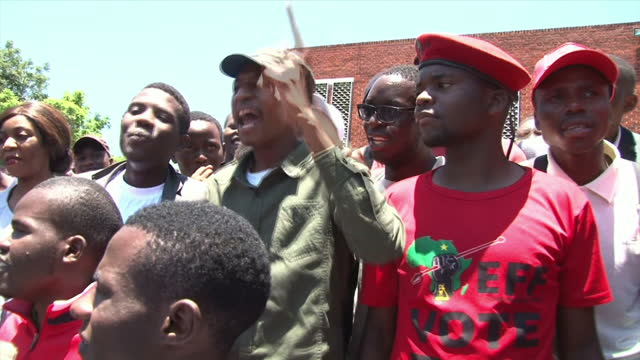 exterior shots of crowds of students gathered outside the university of zimbabwe singing chanting slogans and holding signs praising commander... - harare stock videos and b-roll footage