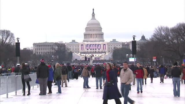 Exterior shots of crowds on National Mall in front of the Capitol Building arriving for the inauguration of Donald J Trump on January 20 2017 in...