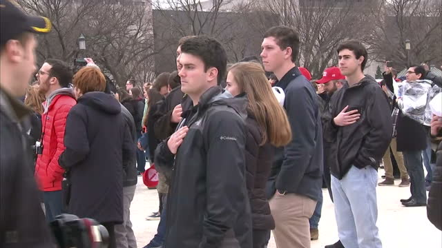 exterior shots of crowds stood with arms on their chests as the star spangled banner is performed during the inauguration of donald trump on january... - amtseinführung stock-videos und b-roll-filmmaterial