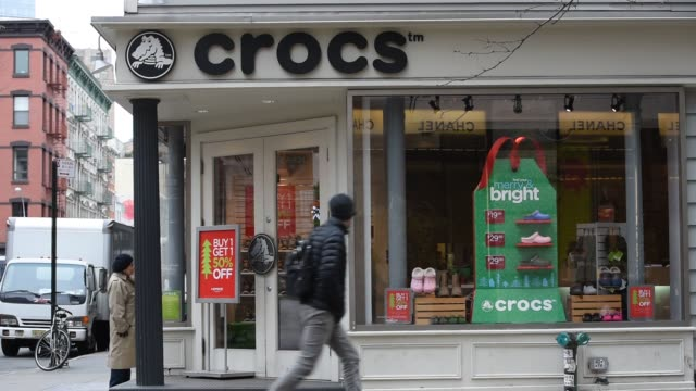 62195ff15d4e3 Exterior shots of customers and commuters walking past a Crocs store in Manhattan  New York Customers