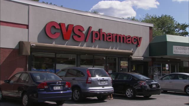 exterior shots of cvs pharmacy, located in the tanglewood shopping center. store showing parked cars and signage. cvs pharmacy on central park ave.... - cvs caremark stock videos & royalty-free footage