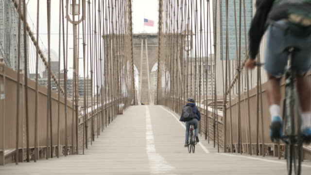 exterior shots of cyclists on brooklyn bridge during coronavirus pandemic on 28 march 2020 in new york city, united states - brooklyn bridge stock videos & royalty-free footage