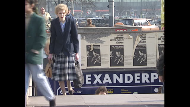 exterior shots of daily life around berlin in the wake of the re-unification of east and west, including election posters, buses and people on the... - east berlin stock videos & royalty-free footage
