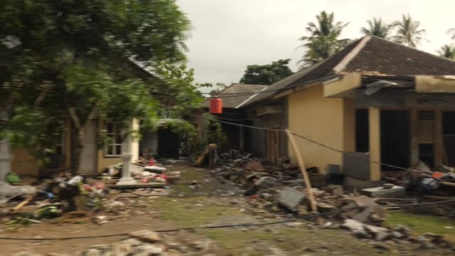 exterior shots of damaged houses boats and people cleaning up after the tsunami hit the region on 26 december 2018 in western java indonesia - tsunami stock videos & royalty-free footage