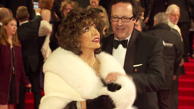 exterior shots of dame joan collins and briefly percy gibson attending the royal world premiere of 'spectre' at royal albert hall on october 26 2015... - spectre 2015 film stock videos and b-roll footage