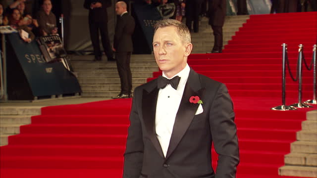exterior shots of daniel craig posing for photo op on the red carpet at the royal world premiere of 'spectre' at royal albert hall on october 27,... - premiere stock videos & royalty-free footage