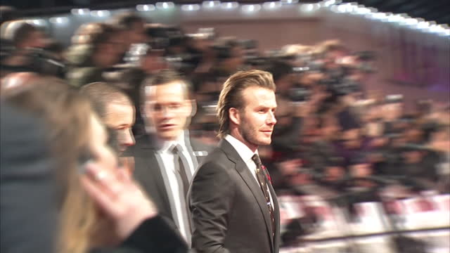 "exterior shots of david beckham on the red carpet at the premiere of ""the class of '92"" greeting fans and guests. london premiere of ""the class of... - premiere stock videos & royalty-free footage"