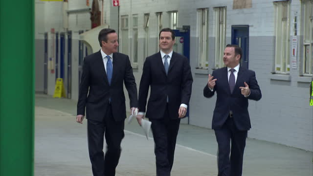 exterior shots of david cameron and george osborne walking into the bombardier train workshops to greet employees on february 12 2015 in derby england - ジョージ・オズボーン点の映像素材/bロール
