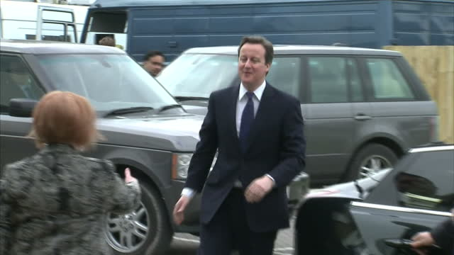 Exterior shots of David Cameron British Prime Minister out of car greeted by woman and walk into building David Cameron Arrives At Tory Spring...