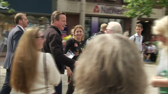 exterior shots of david cameron on the campaign trail meeting voters on 12 may 2017 in nantwich, united kingdom - ナントウィッチ点の映像素材/bロール