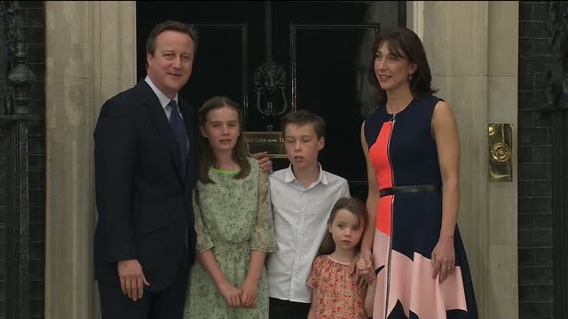 exterior shots of david cameron posing for photos with his wife samantha cameron and children before departing from downing street for the final time... - david cameron politician stock videos & royalty-free footage