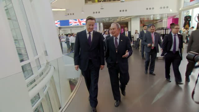 "exterior shots of david cameron speaking to former mayor of new york michael bloomberg saying ""the definition of relief is being the prime minister... - 2014 stock-videos und b-roll-filmmaterial"