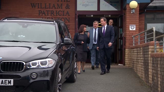 Exterior shots of David Cameron walking from the Age UK building and departing in car on April 10 2015 in Plymouth England