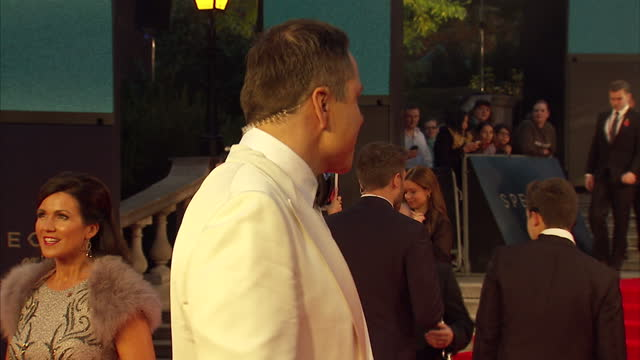 exterior shots of david walliams and susannah reid posing for photo op at the royal world premiere of 'spectre' at royal albert hall on october 27... - spectre 2015 film stock videos and b-roll footage