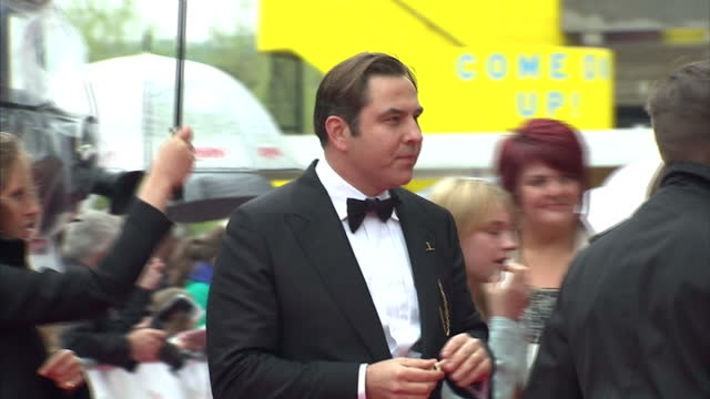 exterior shots of david walliams on red carpet at bafta awards speaking to people david walliams on red carpet at bafta awards at the royal festival... - royal festival hall stock videos and b-roll footage