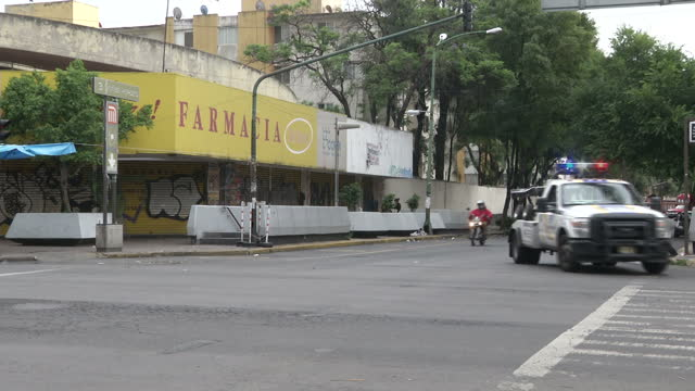 exterior shots of day to day life around mexico city with traffic passing and people walking around and chatting on street corners on july 09, 2015... - drug trafficking stock videos & royalty-free footage
