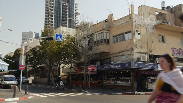 exterior shots of day to day life in ashkelon with people shopping and cars passing through a busy road junction on march 17 2015 in ashkelon israel - ashkelon stock videos and b-roll footage
